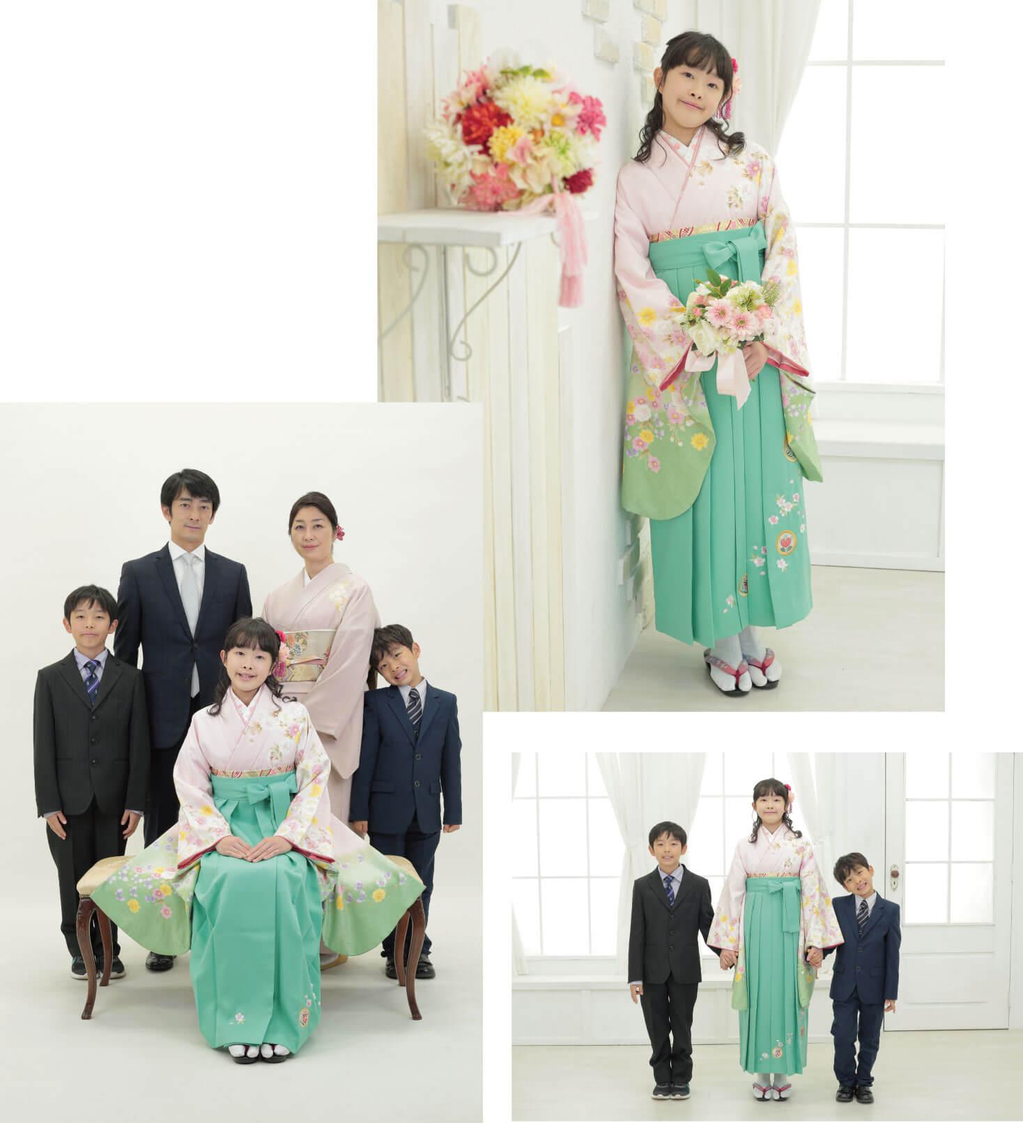 ご家族と小学校卒業の記念写真を撮る女の子